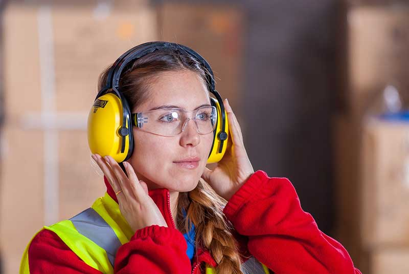 wearing safety glasses and earpads