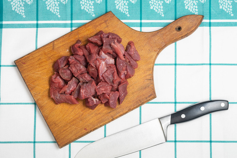 chopping board with knife and meat