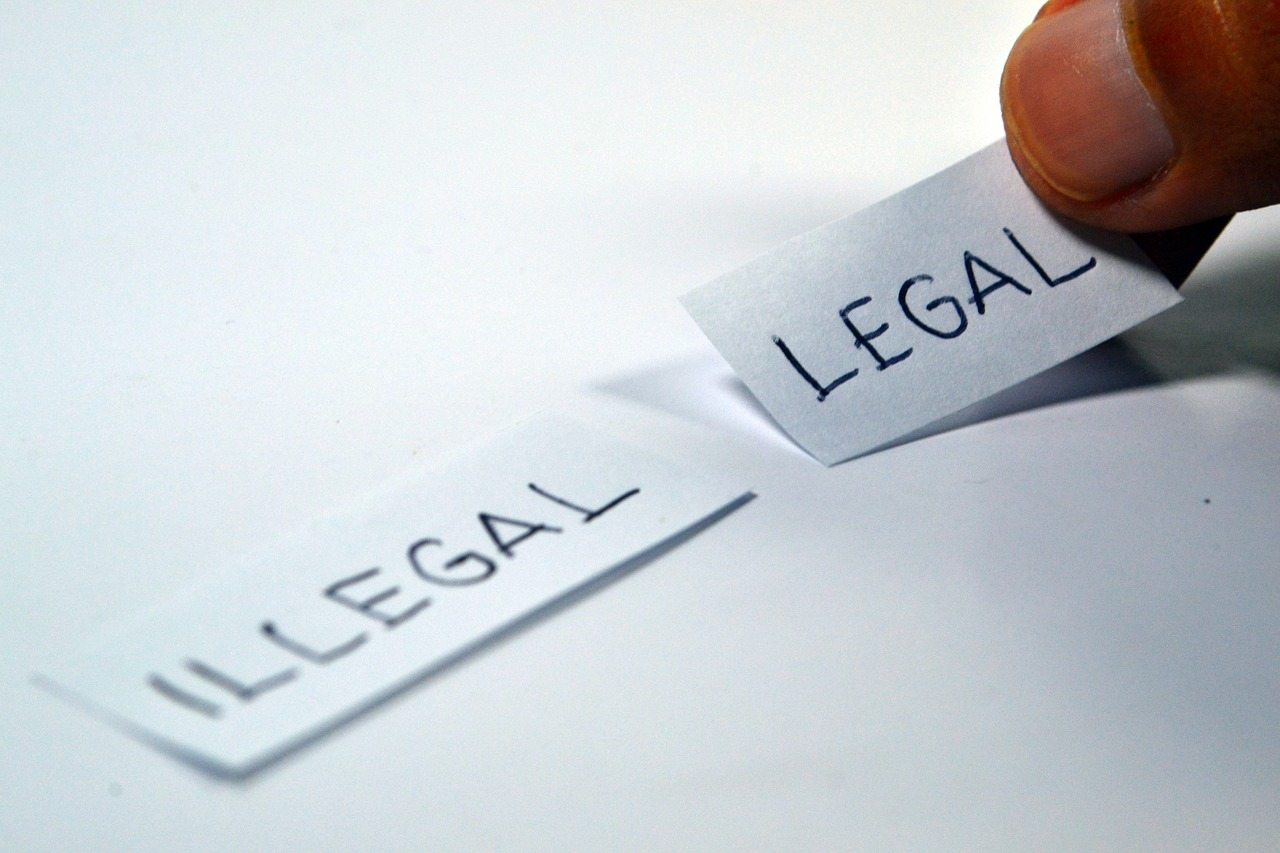 illegal legal written on a paper
